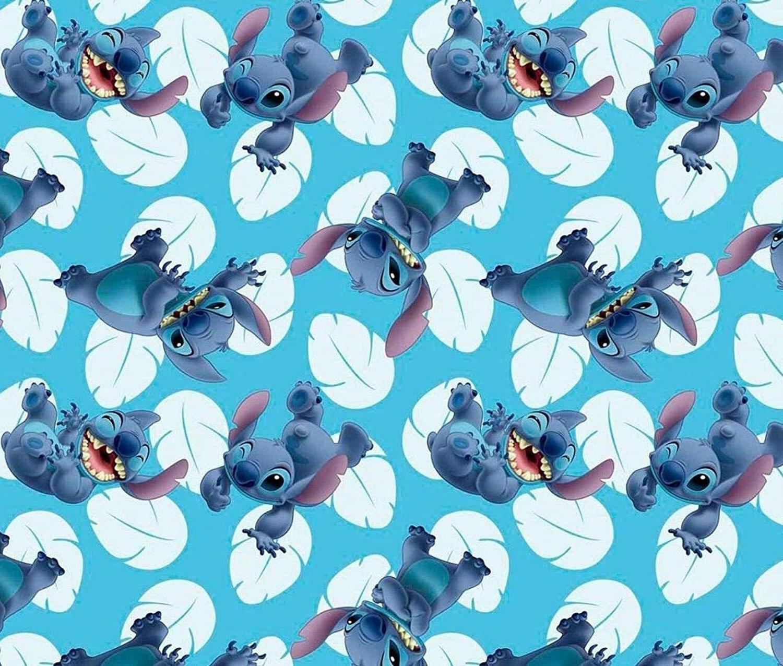 Disney Lilo & Stitch Many Faces of Stitch Toss Cotton Fabric